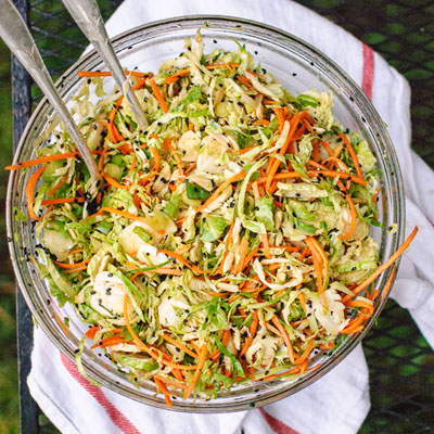 Asian Brussels Sprout Slaw with Carrots and Almonds from cookieandkate.com